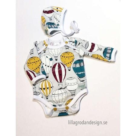 Lilla Babysetet - Hjälmmössa och Body i tyget Luftballonger, Petrol
