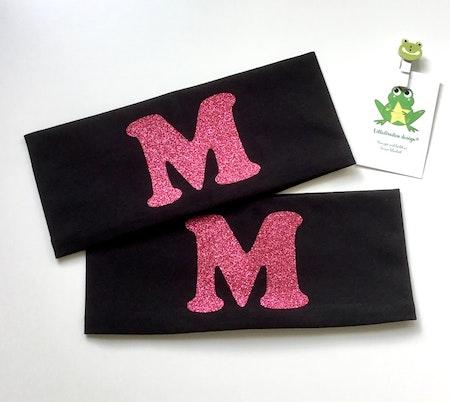Pannband med bokstav i rosa glittervinyl