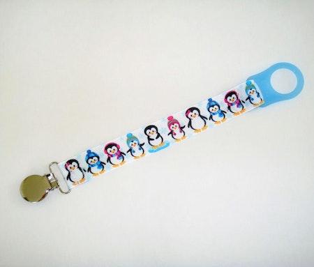 Napphållare med Pingviner - Pingviner, Vit #N123 med blå hållare. Numera används O-ringar ist för hållare.