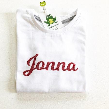 T-shirt - Egen text, Vit med rosa glittervinyl, textstil 2