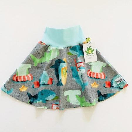 Klockad kjol i tyg Hajar med midjemudd i Mintblått