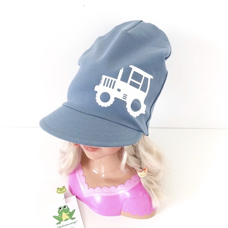 Motivmeps, Enfärgat blågrått med vit vinyl, motiv nr 6 traktor