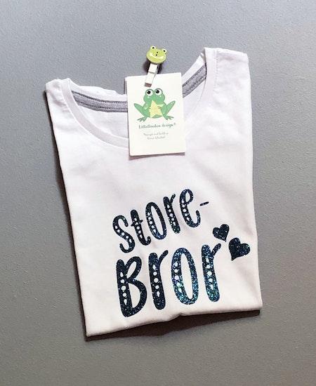 T-shirt storebror, vit med glittervinyl i blågrönt