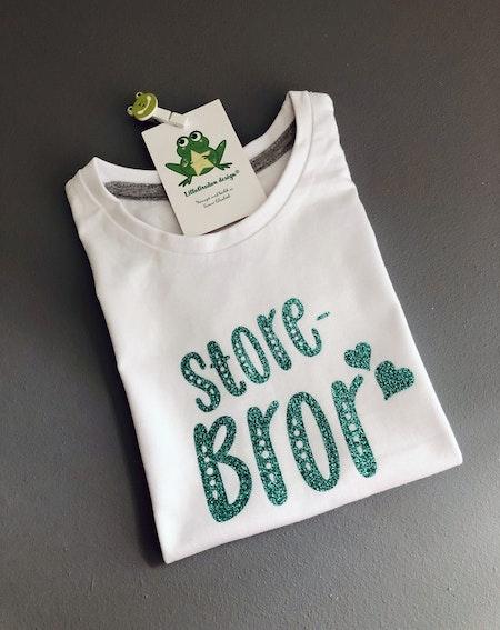 T-shirt storebror, vit med glittervinyl i grönt