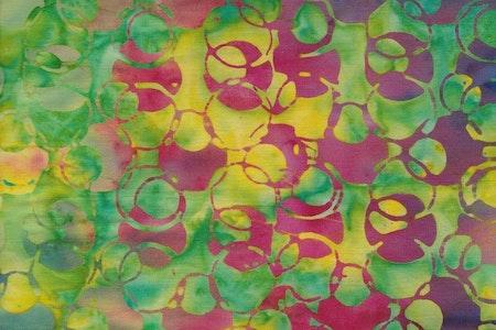 Gul och grön botten med flerfärgat cirkel-tryck