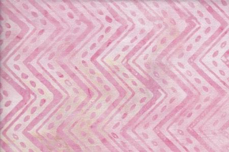 Rosa tryck på vit botten med beige fläckar