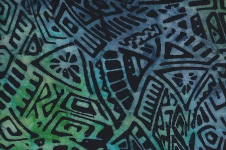 Blågrön  med svart tryck. Viskos. 130 cm bred