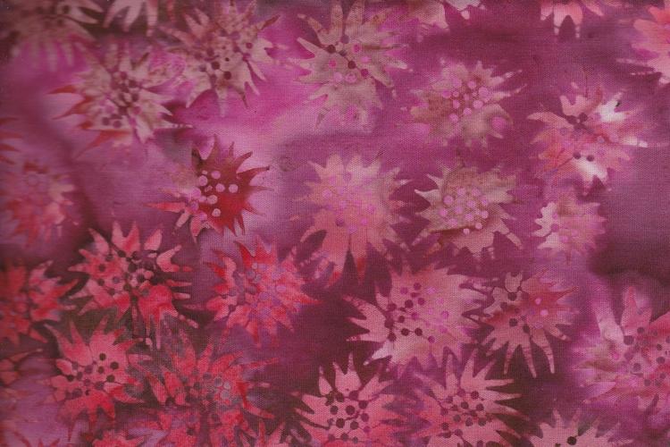 Ceriserött och flere rödaktiga färger. Balibatik i bomull