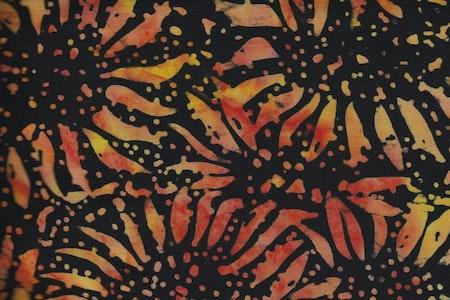Favorit i repris. Solrosor i gul-orange på svart botten