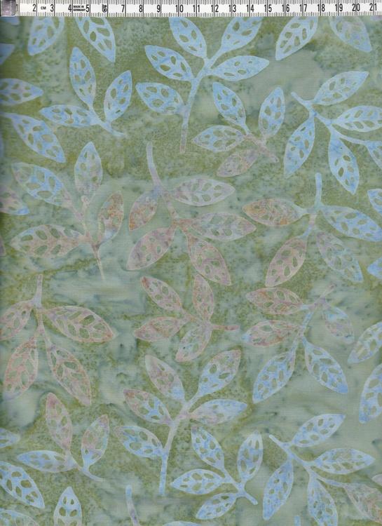 Dämpat grönmelerat med ljusa pastelliga lövmotiv. bomullstyg