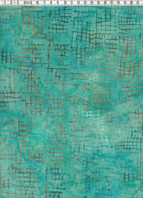 Ljusgrönflammigt med beigeblå rutmönster. Bomullsbatik