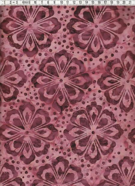 Storblommigt i brunt på rosa-beige-aprikosmurrig bakgrund