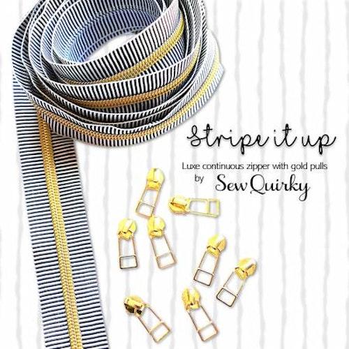 Randig dragkedja i vitt & svart, guldfärgad dragkedja & 8 kläppar, storlek #5, 3 meter. Från Sew Quirky