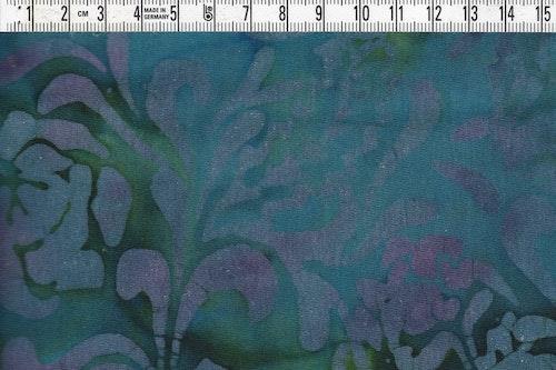 Blålila med lite gröna inslag. Trikåtyg 100% bomull. 170 cm brett