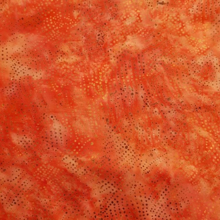Superfräscht i rödorange och prickar. 145 cm bred