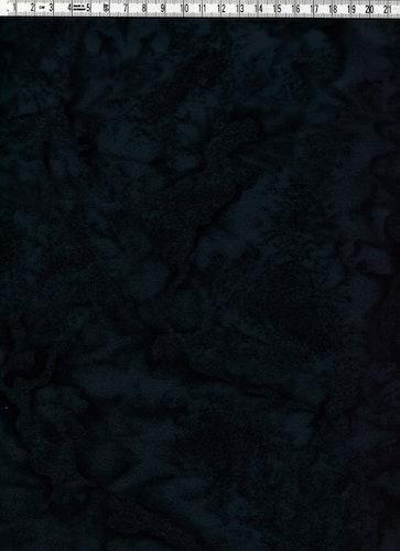 Mörkgrått och svart melerat bomullstyg. Bredd 110 cm.