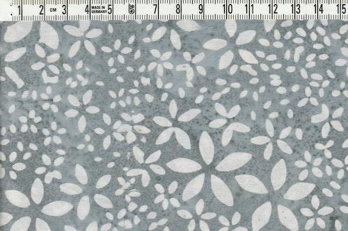 Små ljuva blommor i vitt på grått.  Bomullsbatik