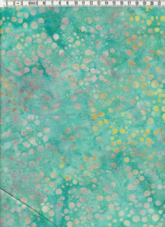 Friska gröna färger med flerfärgade prickar. Bomullsbatik