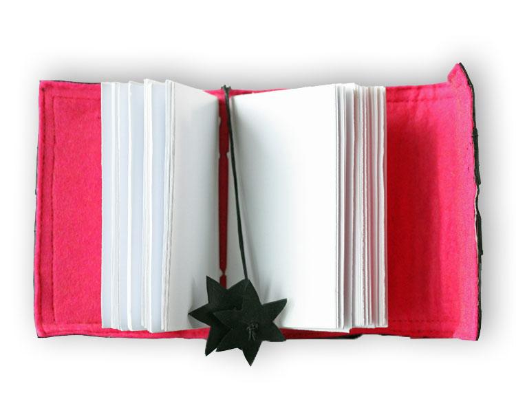 Anteckningsbok återvunnet papper med rosa insida