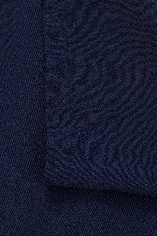 Närbild på tunikans blå färg. Finns även i fler färger.