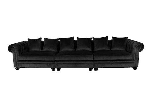 Svart sammet soffa