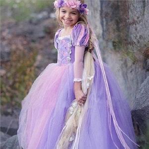 Disney prinsessa Rapunzel, klänning barn strl.9