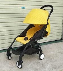 Stilren sulkyvagn med tillbehör, gul