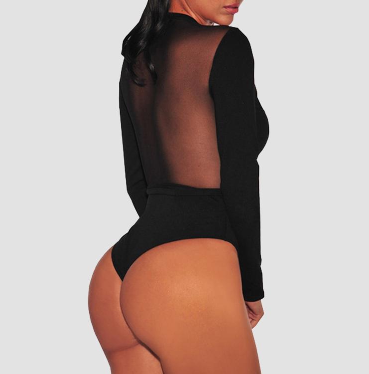 Snygg svart långärmad body med spännen fram och genomskinlig rygg