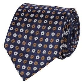Blåmönstrad slips i vävd siden