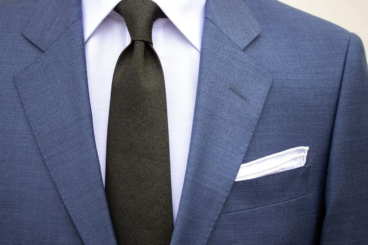 Ljusblå melerad kostym
