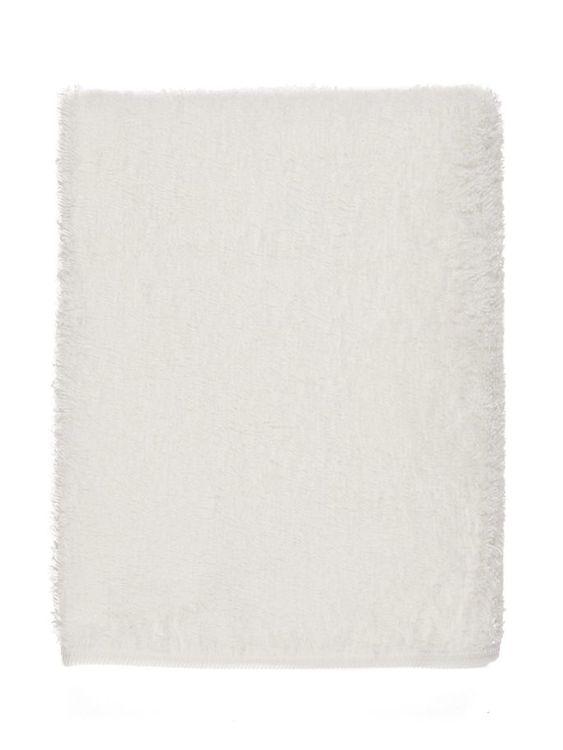 Mjuk badhandduk  för bebisar med huva från Name it med brodyr på huvan. Bredd: 76 cm. Längd: 76 cm Huva: 21 cm från hörn till öppning Material: 90% Bomull, 9% Polyester & 1% Elastan   Färg: Vit