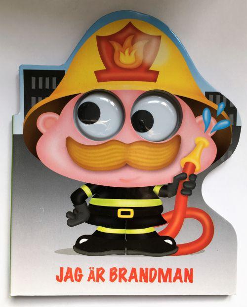 """Jag är Brandman är en söt pekbok & Brandmannens stora snälla ögon följer glatt barnen när de läser om honom. """"Jag ä Brandman alltid snabb att rycka ut. jag släcker eldar & kommer med ett tjut"""""""
