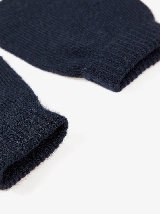 Praktiska, enfärgade stickade tumvantar från Name it med ribbad öppning. Material: 95% Akryl och 5% Elastan. One Size   Färg: Marinblå