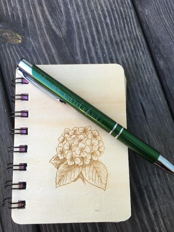 Notisbok och penna