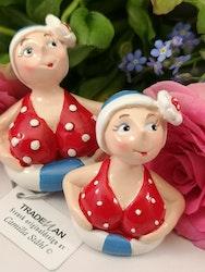 Badande damer i badring