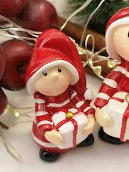 Tomtenissar med julklappar.