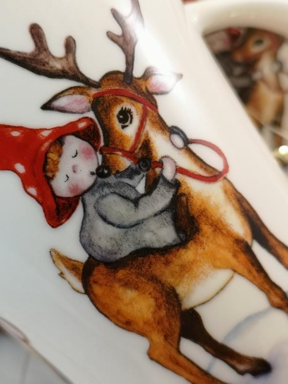 Rudolf med röda mulen på kaffemugg