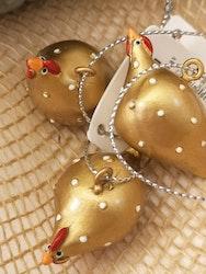 Höna guld, hängande