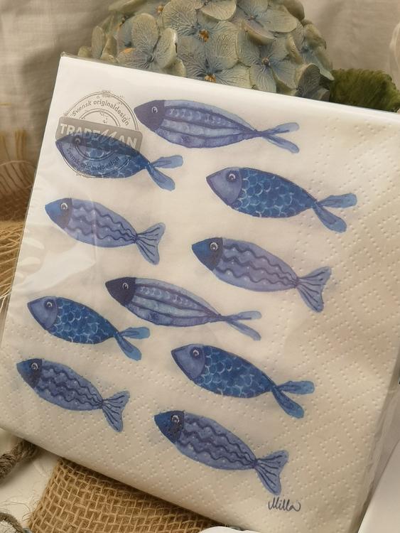 Servetter med blåa fiskar
