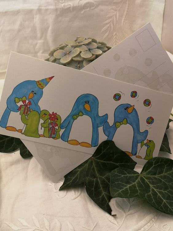 Avlångt kort med pingviner