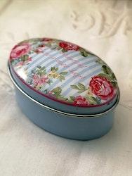 Oval burk med rosor och text
