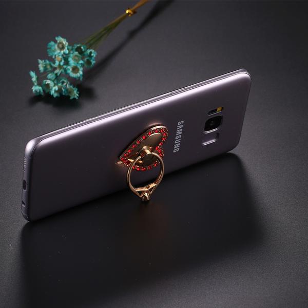 Mobilhållare Hjärtformad med ring och röda diamanter