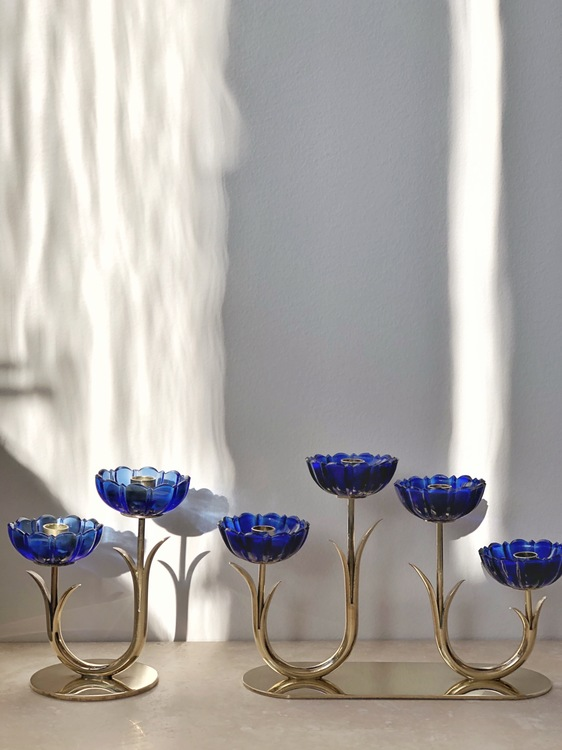 Gunnar Ander set of 2 Brass Candle Holders by Ystad Metall with blue glass flowers. 1960s.