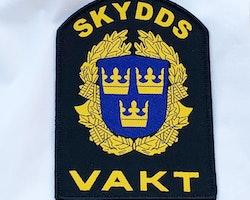 Skyddsvakt Rundad Tygmärke