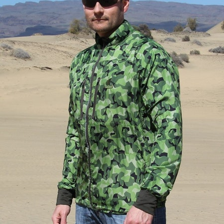 Side view of a Running Jacket M90 MI in desert scenery.