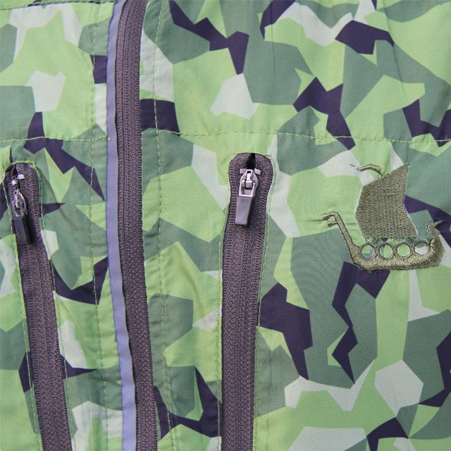 Close up of breast pockets zippers and embroidered logo.