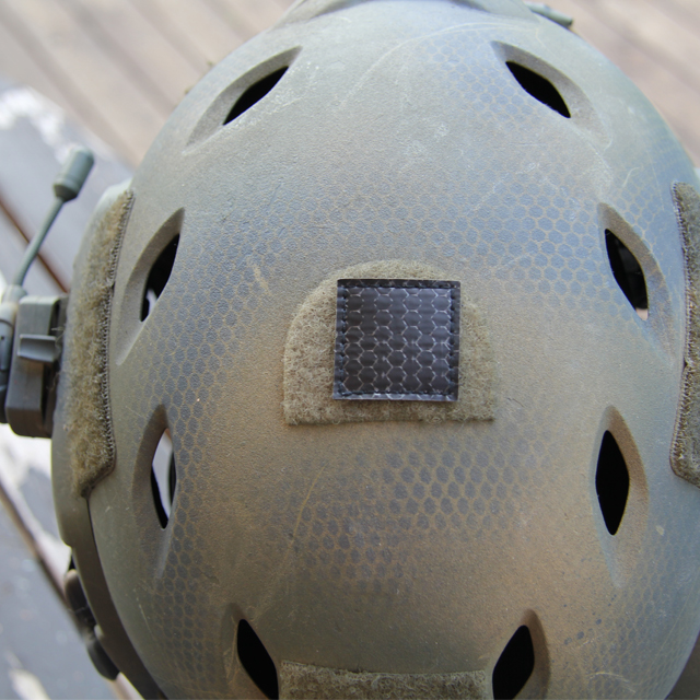 A IR Tactical Glint Square - 3 cm mounted on the top of an Ops Core Helmet.