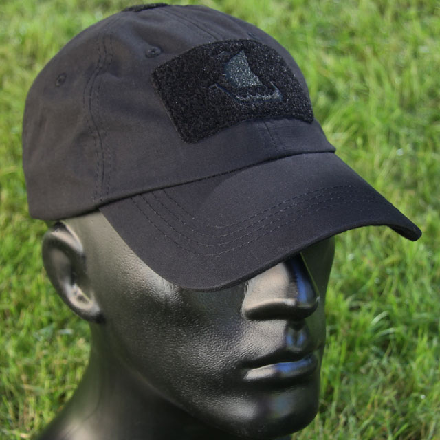 Green grass background of photoshoot of the Baseball Cap Black.