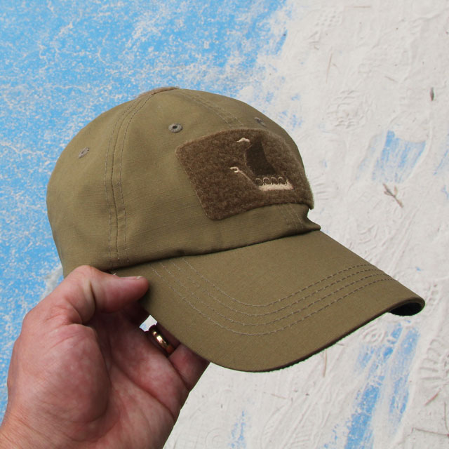Coyote colored tactical baseball cap.