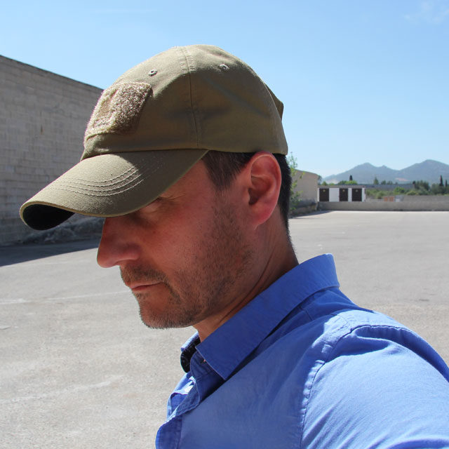 Shading from the sun under a Baseball Cap Coyote.